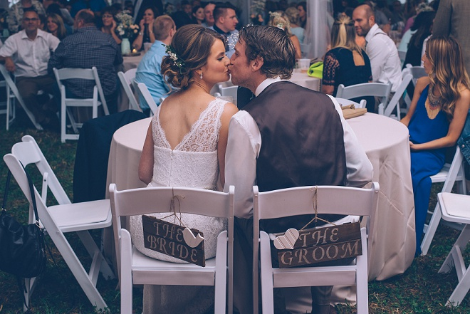 We're loving this gorgeous wedding and these fun wooden Bride and Groom chair signs!