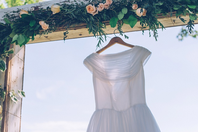 We're swooning over this Bride's vintage wedding dress at this gorgeous outdoor DIY wedding!