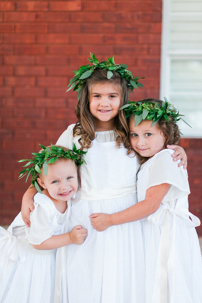 Dying over these darling flower girls in their green flower crowns and ribbon shoes!