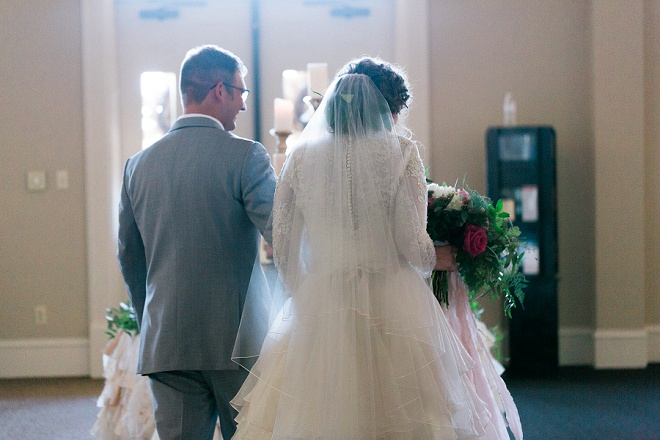 Darling shot of the Bride and Groom entering their reception as Mr. and Mrs!