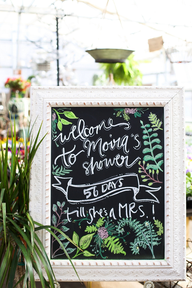 We love this gorgeous hand lettered chalkboard for this DIY garden bridal shower!