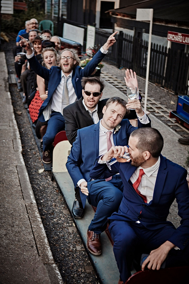 What a fun shot of the Groomsmen at the train museum for the DIY reception!