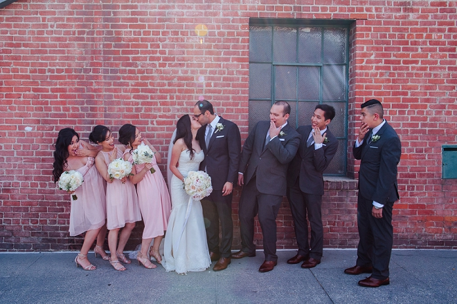 Loving this fun shot of the Bridal Party and Bride and Groom on their big day!