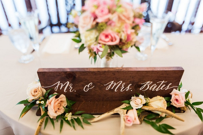 We're in love with this gorgeous hand lettered wooden Mr. and Mrs. sign for this couples sweetheart table!