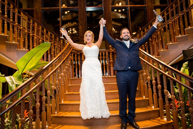 We love this fun shot of the new Mr. and Mrs. entering their crafty country reception!