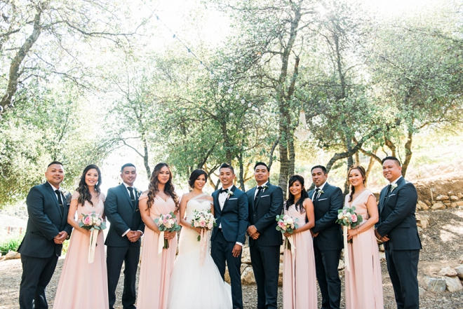 Gorgeous bridal party with the new Mr. and Mrs. after this gorgeous ceremony!