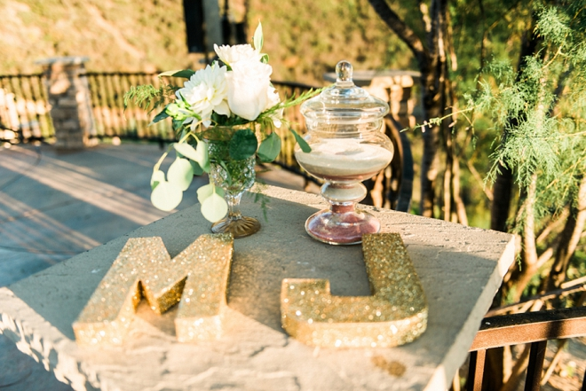 Loving the gold glitter monogram details at this gorgeous California wedding!
