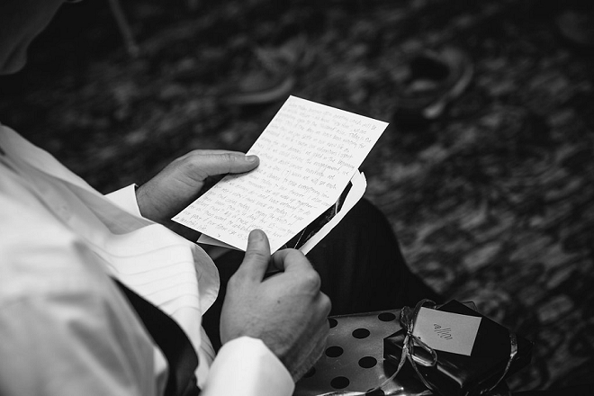 Love this shot of the Groom reading a note from his Bride the morning of their wedding!
