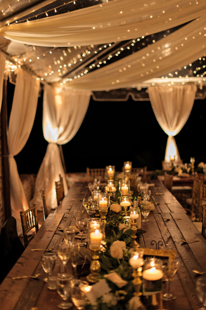 a combination of fabric and twinkle lights make for a beautiful layered look in a wedding & 15 Awesome Ideas To Make Your Wedding Tent Shine!
