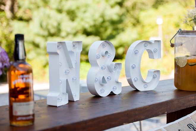 Loving the monogrammed features at this boho backyard wedding!