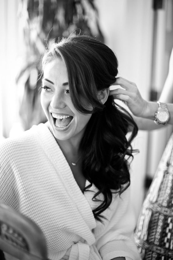Gorgeous Bride Having Her Side Ponytail Styled By Hairdresser