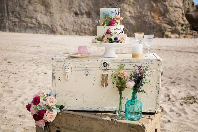 We're swooning hard over this stunning cake and vintage rental display!