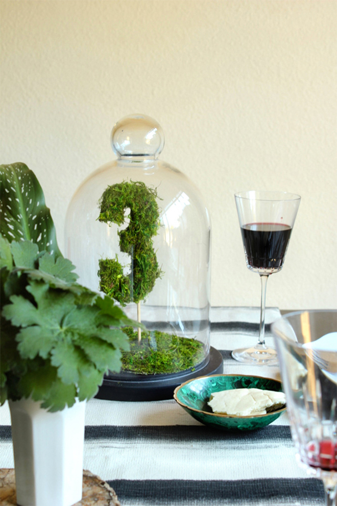 DIY moss table numbers double as a beautiful centerpiece.