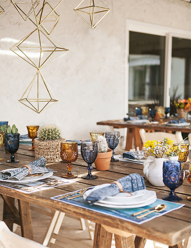 hanging geometric shapes draw the eyes up from the table.