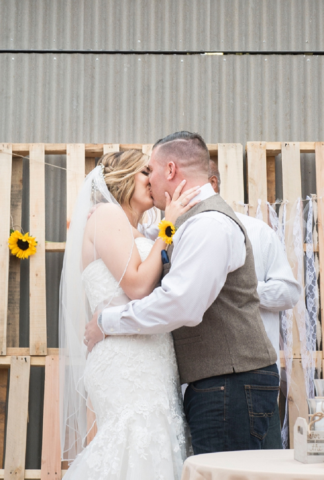 We love this first kiss as Mr. and Mrs!