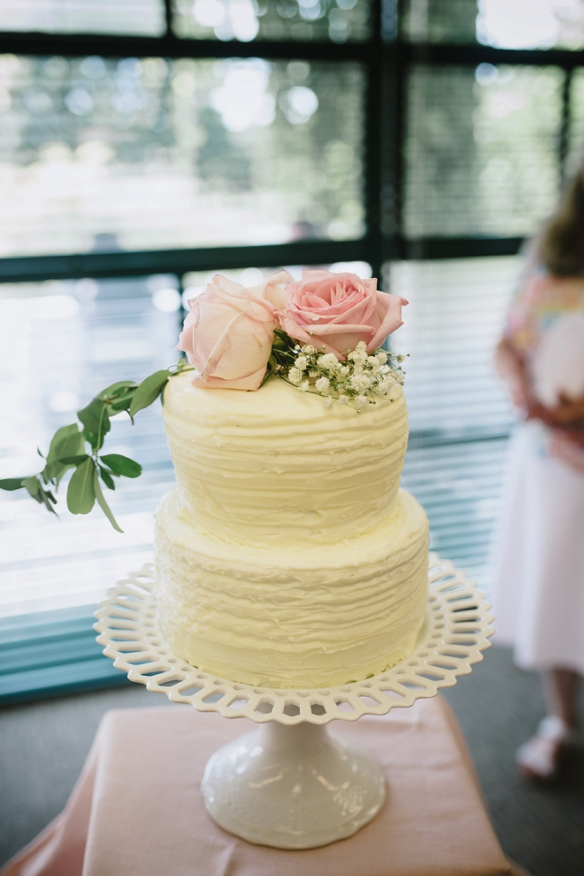 We love this darling simple wedding cake with garden rose topper! LOVE!