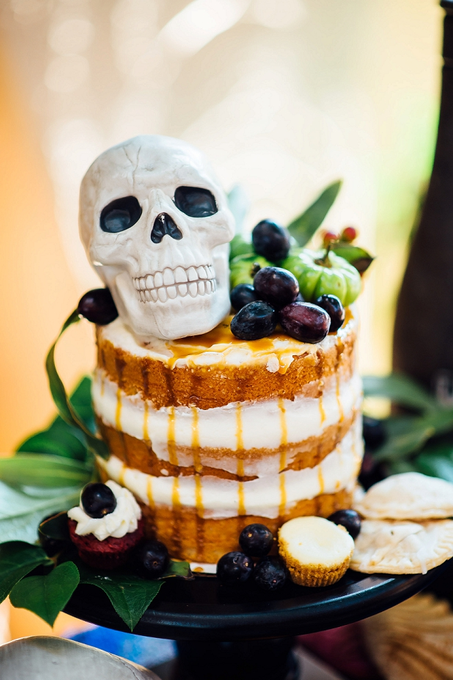 We can't get over this fun cake with skull cake topper at this styled Day of the Dead wedding shoot!