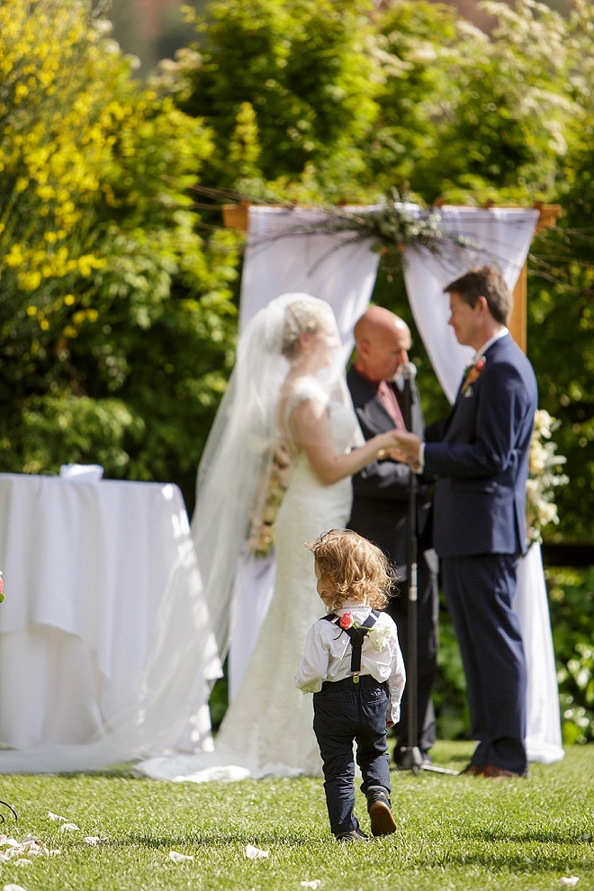 How cute is this darling ring bearer?!
