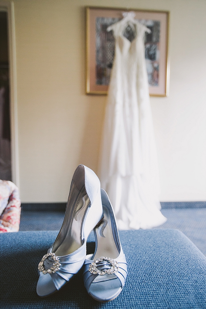 We love this Bride's blue wedding shoes and stunning dress for the big day!
