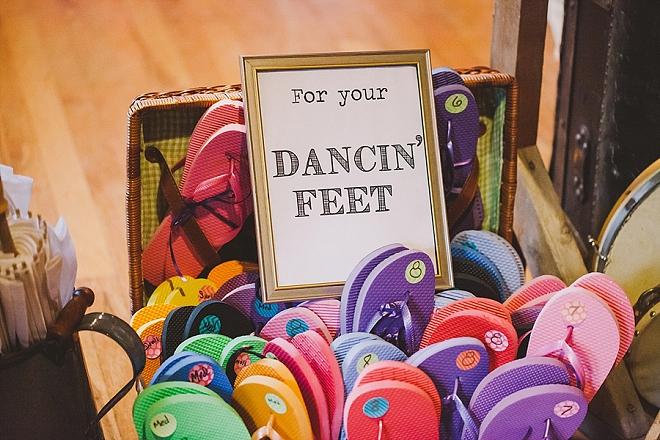 Fun dancing feet flip flops for their fun filled reception!