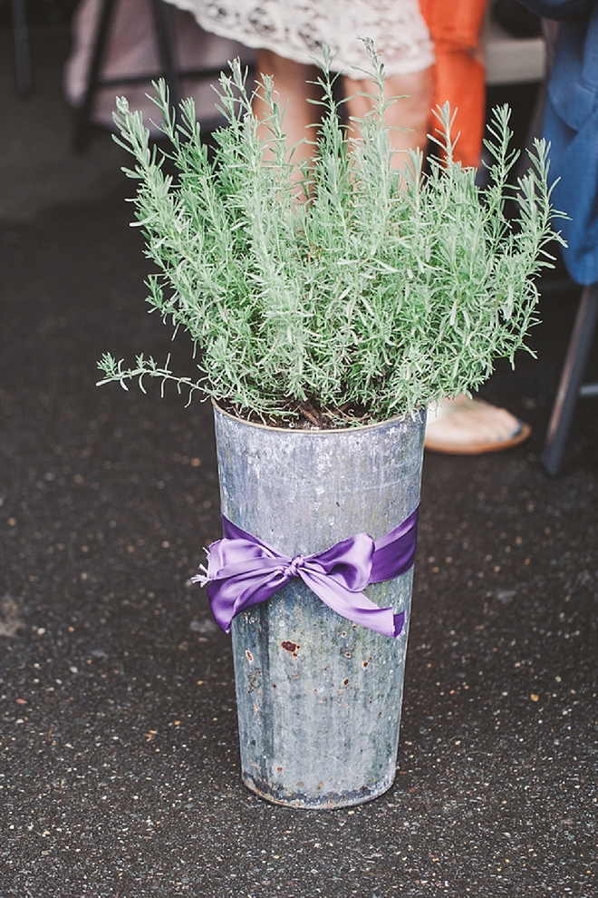 We love these lavender bouquets lining the ceremony!