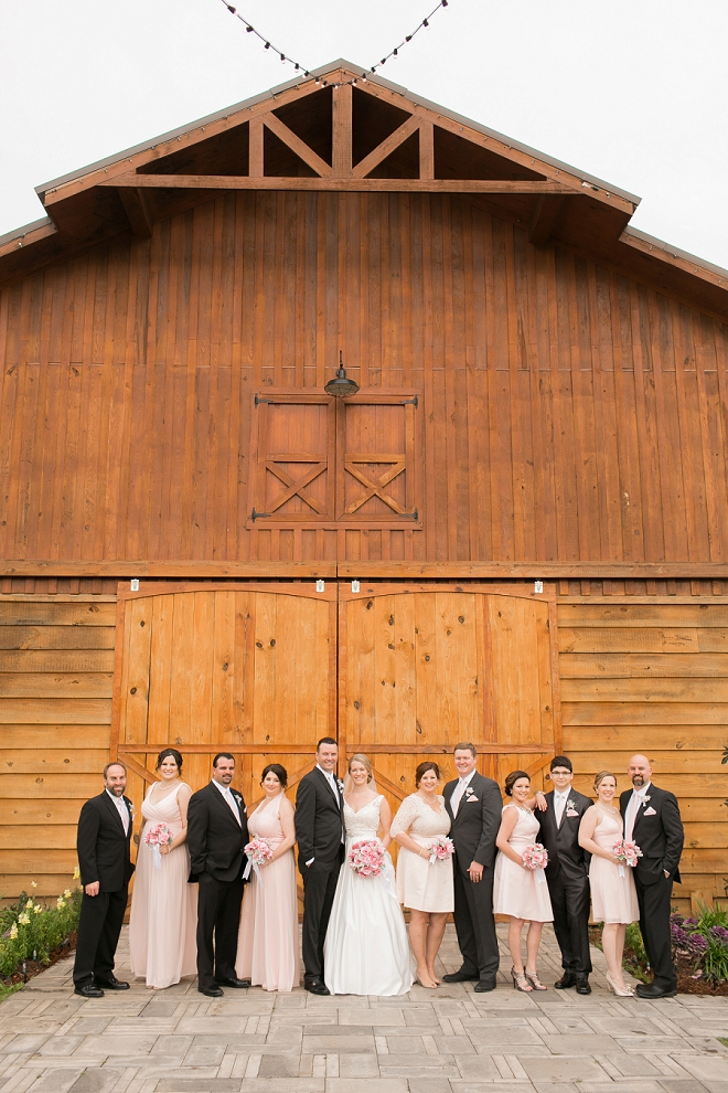 We love this cute snap of the black and blush wedding party!