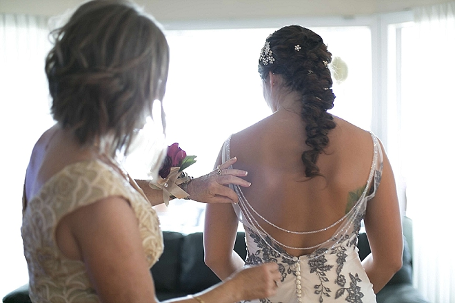 We love this DIY'd back necklace perfect on this Bride!