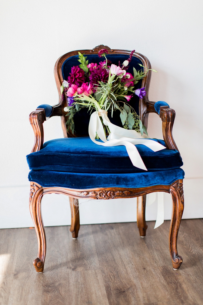 We couldn't be more in love with this gorgeous blue chair or the stunning bouquet!