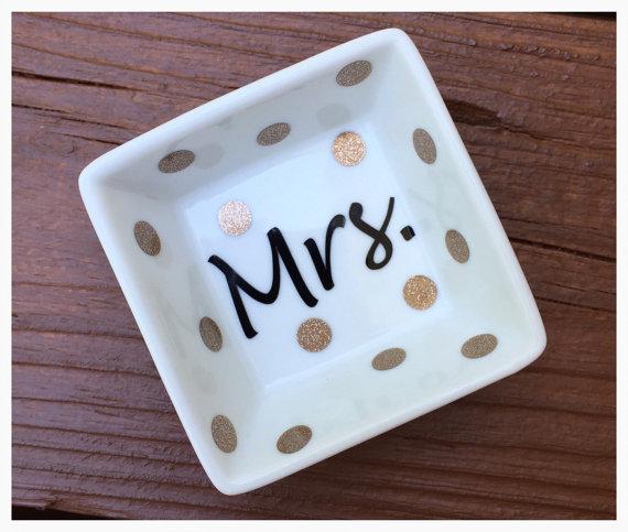 Crushing on this darling gold polka dot Mrs engagement ring dish!