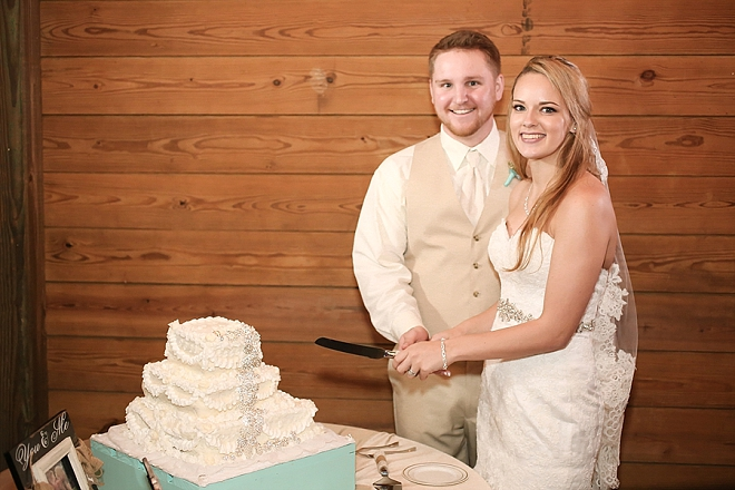 We love this darling couple cutting the cake at their reception!