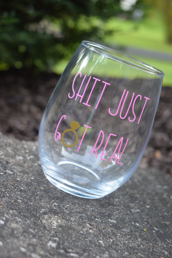 We LOVE this hilarious Shit Just Got Real engaged wine glass! It's a must have for every new bride!