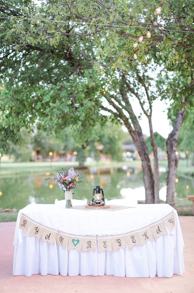 Loving this Mr. and Mrs. sweetheart table at their backyard wedding!
