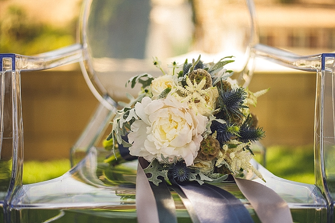 Loving this white and green boho chic bouquet at this styled wedding!