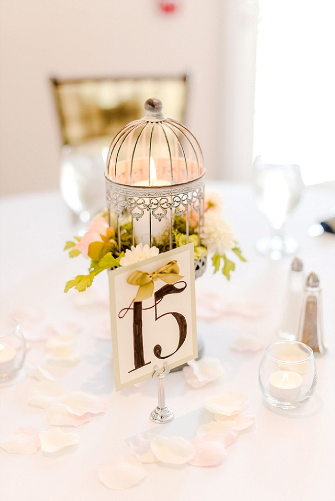 Check out these darling centerpieces and table numbers with vintage birdcages!