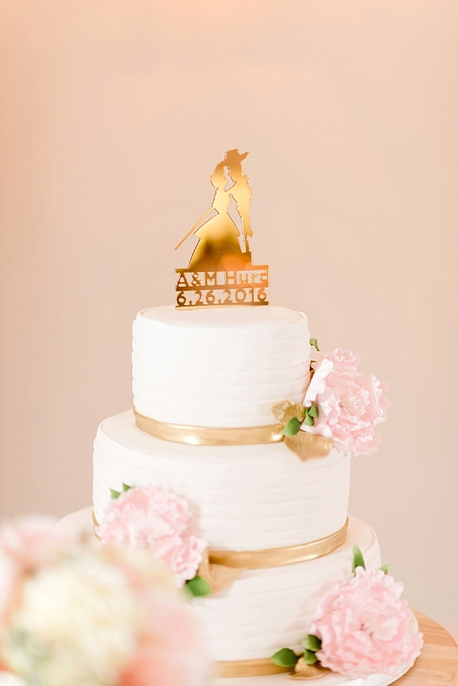 We love this stunning wedding cake with a cake topper of their engagement - so cute!