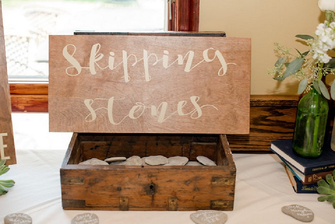 How cute is this skipping stones display at this couple's fun lakeside wedding?! LOVE!