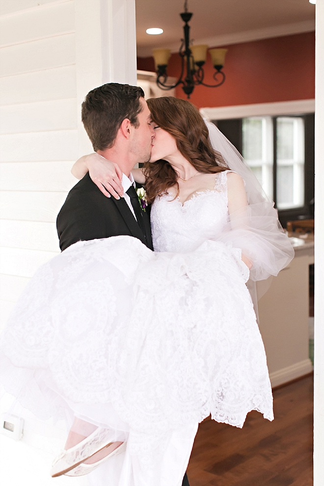 How adorable!! This Groom carried his Bride over the threshold of their home!