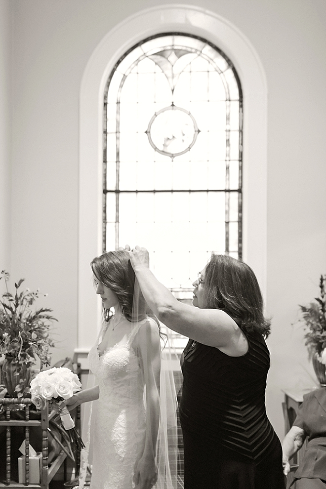 Such a sweet snap of this Bride and her Mom doing finishing touches before the ceremony!