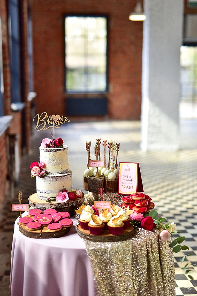 We're swooning over this super glam dessert table with customized wooden accents!