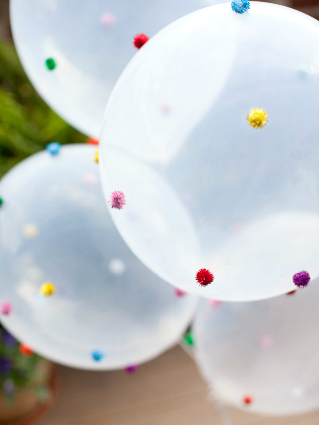 DIY Pom-pom balloons.  Such a fun idea for a wedding or birthday party!