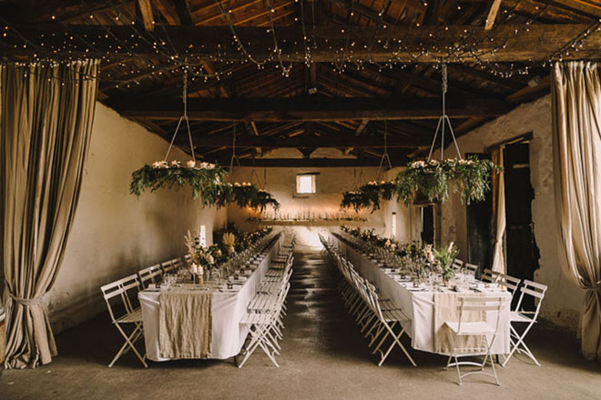 Folding chairs make a simple stunning statement at a wedding.