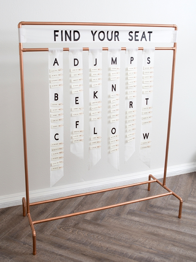 This DIY copper pipe seating card display is seriously awesome!