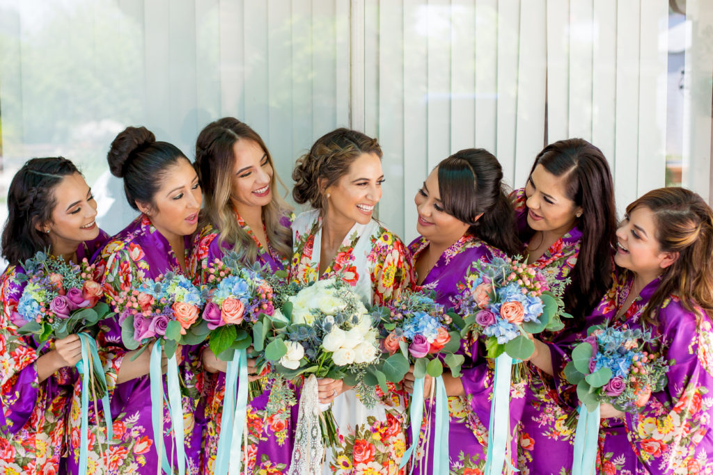 How stunning are these gorgeous Bridesmaids with their Bride?! LOVE!