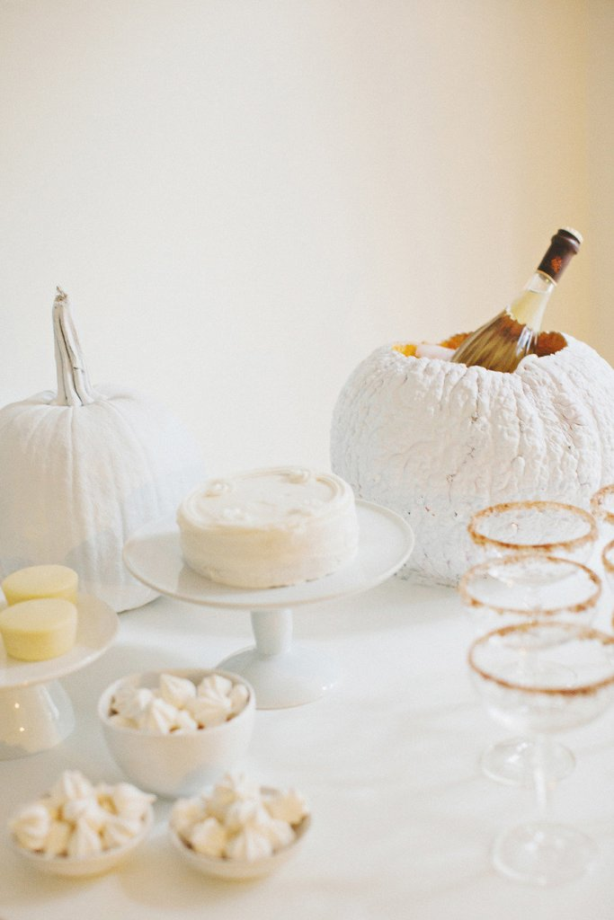 What an awesome idea! A white pumpkin ice bucket made out of a REAL pumpkin.  Major fall wedding inspo.