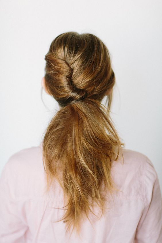 Try a twisted ponytail for your winter wedding.
