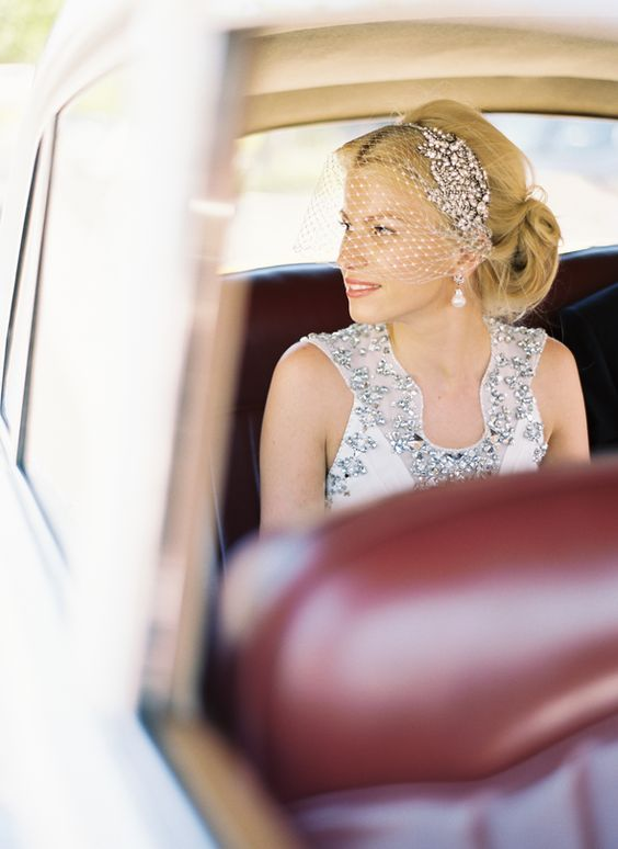 A crystal headpiece + birdcage veil is perfect for your winter wedding.