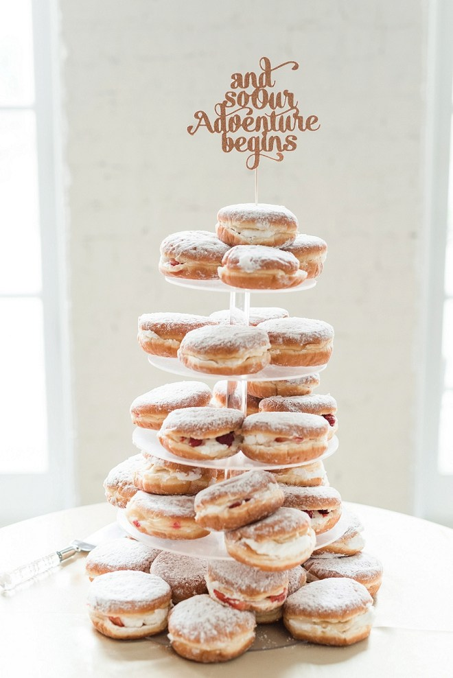 When your cake is made of cream filled donuts with a darling cake topper? You win our hearts!