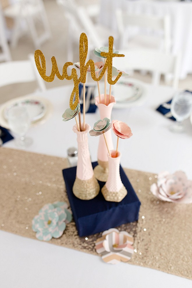 How darling are these gold glittery table numbers at this gorgeous DIY spring wedding!