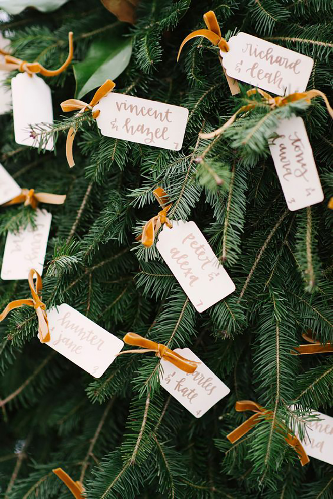 Escort cards tied to garlands or trees is a magical idea!