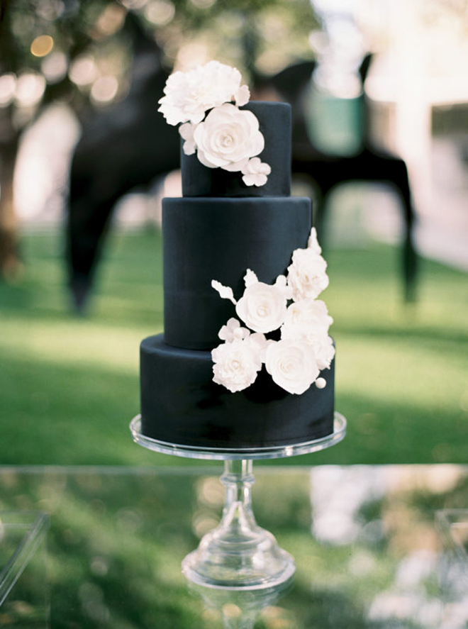 A black cake gives a sophisticated, modern vibe.